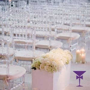Clear ghost chiavari chairs at wedding ceremony