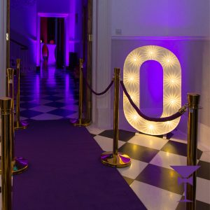 Purple Carpet Hire With Gold Stanchion posts